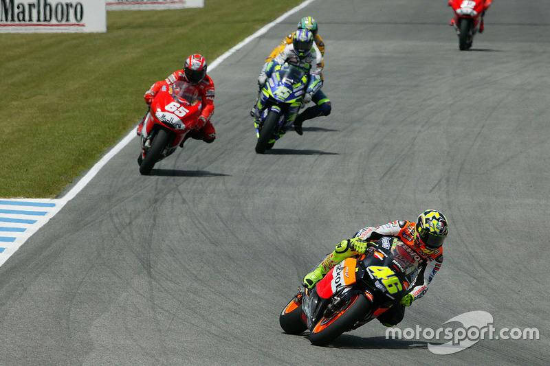 "<img src=""http://cdn-1.motorsport.com/static/custom/car-thumbs/MOTOGP_2017/RIDERS_NUMBERS/Rossi.png"" width=""55"" /> #26 GP d'Espagne 2003"