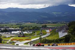 Sebastian Vettel, Ferrari SF71H, leads a Toro Rosso