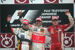Heikki Kovalainen, Renault R27 with Lewis Hamilton, McLaren Mercedes MP4/22 and Kimi Raikkonen, Ferrari F2007 celebrate on the podium