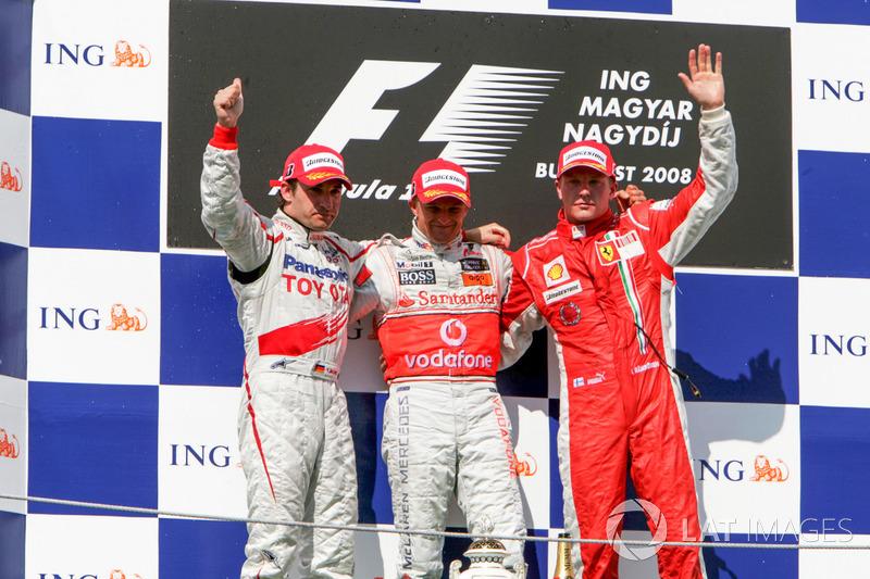 Podium: second place Timo Glock, Toyota Racing, Race winner Heikki Kovalainen, McLaren, third place Kimi Raikkonen, Ferrari