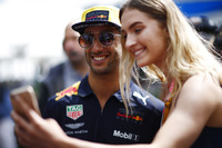 Daniel Ricciardo, Red Bull Racing, poses for a selfie with a fan