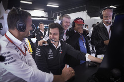 Toto Wolff, Executive Director (Business), Mercedes AMG, Niki Lauda, Non-Executive Chairman, Mercedes AMG, Dr Dieter Zetsche, CEO, Mercedes Benz, and others celebrate after their drivers secure the front row