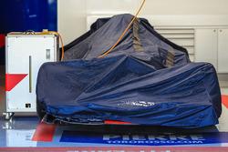 Scuderia Toro Rosso STR12 under covers in the garage
