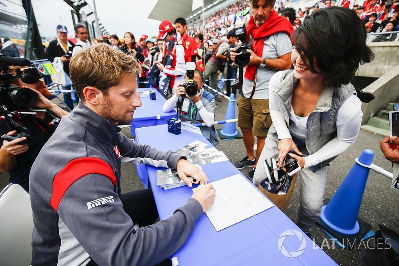 Romain Grosjean, Haas F1 Team, signs an autograph