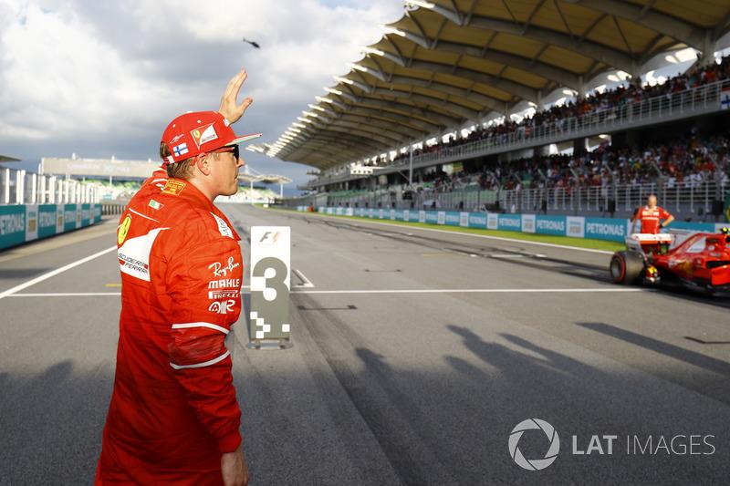 Kimi Raikkonen, Ferrari, waves to fans after qualifying second