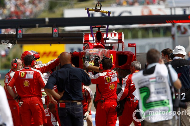 The Ferrari F60 of Felipe Massa is returned to the pits