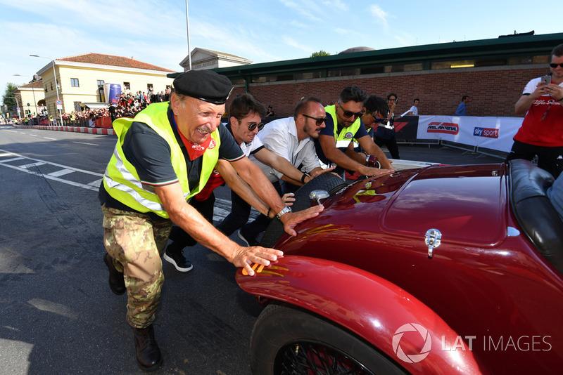 Charles Leclerc, Alfa Romeo Sauber F1 Team helps to push a vintage car