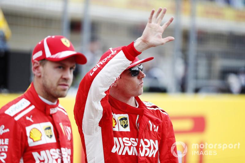 Sebastian Vettel, Ferrari, and Kimi Raikkonen, Ferrari, wave to the fans.