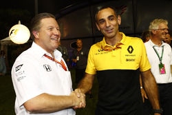 Zak Brown, Executive Director, McLaren Technology Group, Cyril Abiteboul, Managing Director, Renault Sport F1 Team, shake hands in the paddock