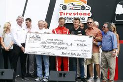 Sébastien Bourdais, Dale Coyne Racing Honda and Patrick Long present a check to Johns Hopkins All Children's Hospital
