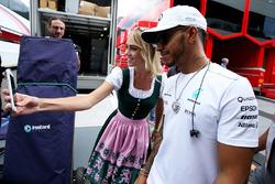 Lewis Hamilton, Mercedes AMG F1, has his photo taken, a grid girl