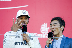 Race winner Lewis Hamilton, Mercedes AMG F1, tries on the Indy 500 winners ring belonging to interviewer Takuma Sato