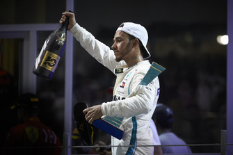 Lewis Hamilton, Mercedes AMG F1, 1st position, with his trophy and Rose Water on the podium