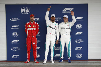 Top three Qualifiers, second placed Sebastian Vettel, Ferrari, pole man Lewis Hamilton, Mercedes AMG F1, and Valtteri Bottas, Mercedes AMG F1