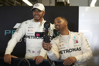Lewis Hamilton, Mercedes AMG F1 and Will Smith in the garage