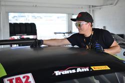 Crews work on the #11 TA2 Dodge Challenger, Henri Tuomaala, Stevens Miller Racing