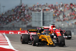 Carlos Sainz Jr., Renault Sport F1 Team RS17 and Sebastian Vettel, Ferrari SF70H
