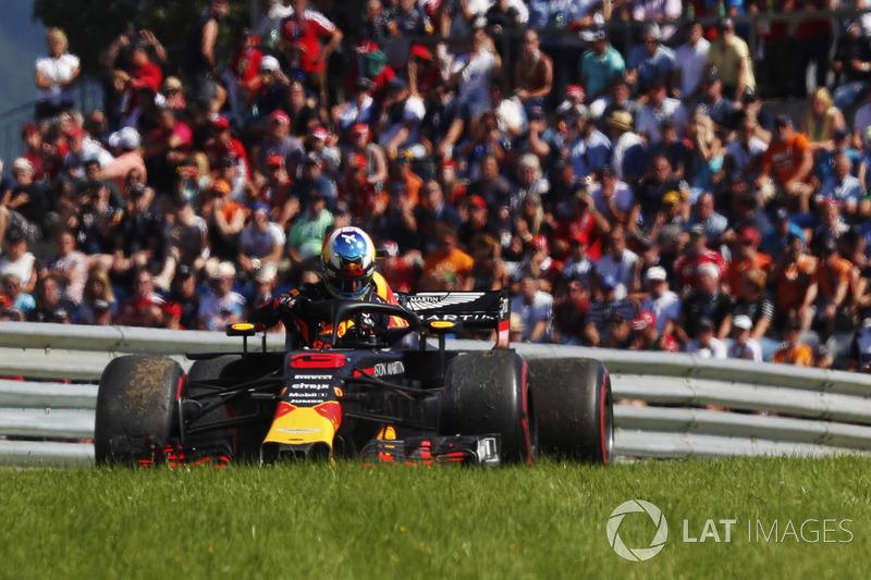 Daniel Ricciardo, Red Bull Racing, exits his car after retiring