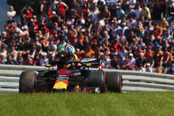 Daniel Ricciardo, Red Bull Racing, exits his car after retiring