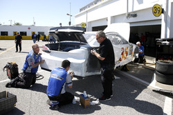 Mechanics are working on the car of David Gilliland, Front Row Motorsports Ford