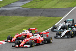 Sebastian Vettel, Ferrari SF16-H and team mate Kimi Raikkonen, Ferrari SF16-H battle for position
