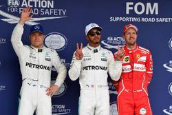 Il poleman Lewis Hamilton, Mercedes AMG F1, il secondo qualificato Valtteri Bottas, Mercedes AMG F1, il terzo qualificato Sebastian Vettel, Ferrari
