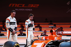 Race drivers Stoffel Vandoorne and Fernando Alonso on stage at the launch of the McLaren MCL32
