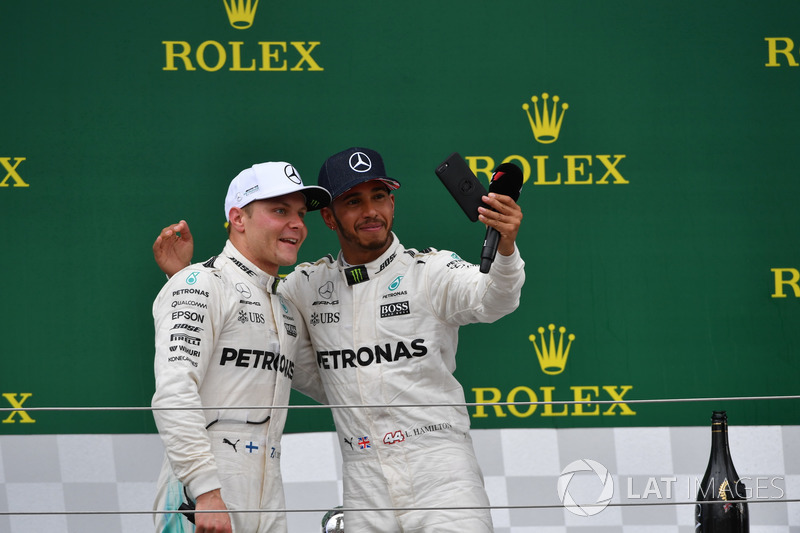 Lewis Hamilton, Mercedes AMG F1 y Jenson Button, McLaren en el podio