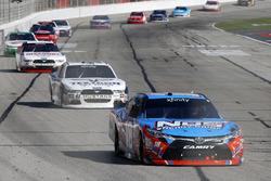 Kyle Busch, Joe Gibbs Racing Toyota leads Kevin Harvick, Stewart-Haas Racing Ford