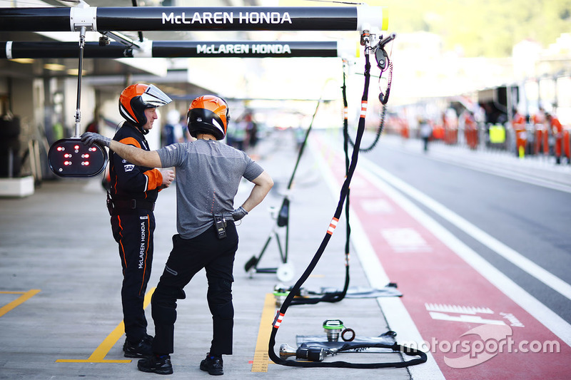 McLaren pit crew in the pit lane