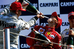 Podium: Mika Hakkinen, McLaren and race winner Michael Schumacher, Ferrari