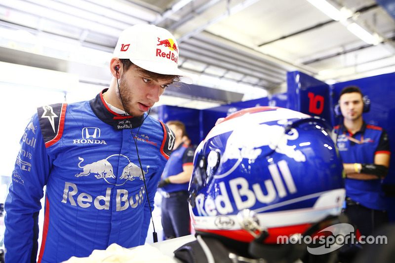 Pierre Gasly, Toro Rosso, examines his crash helmet
