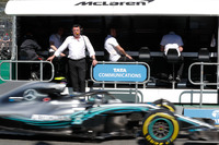 Eric Boullier, Racing Director, McLaren, on the pit wall as Valtteri Bottas, Mercedes AMG F1 W09, passes