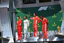Claudio Albertini, Ferrari Engineer, Lewis Hamilton, Mercedes-AMG F1, Sebastian Vettel, Ferrari and Kimi Raikkonen, Ferrari celebrate on the podium