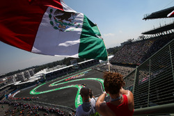 Carlos Sainz Jr., Renault Sport F1 Team RS17 passes fan with Mexican flag in the grandstand