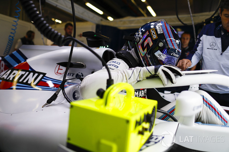 Lance Stroll, Williams Racing, settles into his seat