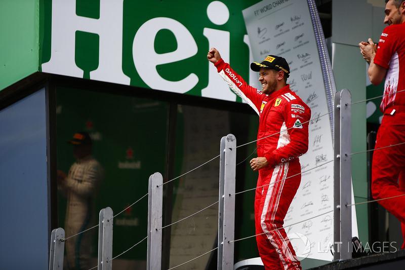 Sebastian Vettel, Ferrari, 1st position, celebrates as he arrives on the podium