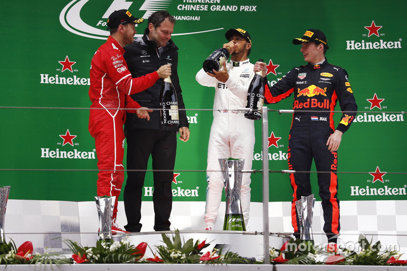 Podium: second place Sebastian Vettel, Ferrari, Aldo Costa, Engineering Director, Mercedes AMG, Race winner Lewis Hamilton, Mercedes AMG, third place Max Verstappen, Red Bull Racing, celebrate on the podium with Champagne