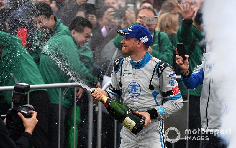 Edoardo Mortara, Venturi Formula E celebrates 2nd position on with his team below the podium