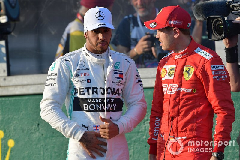 Lewis Hamilton, Mercedes AMG F1, and Sebastian Vettel, Ferrari, talk after qualifying