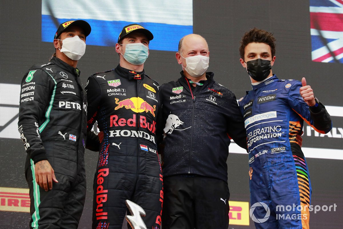 Lewis Hamilton, Mercedes, 2nd position, Max Verstappen, Red Bull Racing, 1st position, the Red Bull trophy delegate and Lando Norris, McLaren, 3rd position, on the podium
