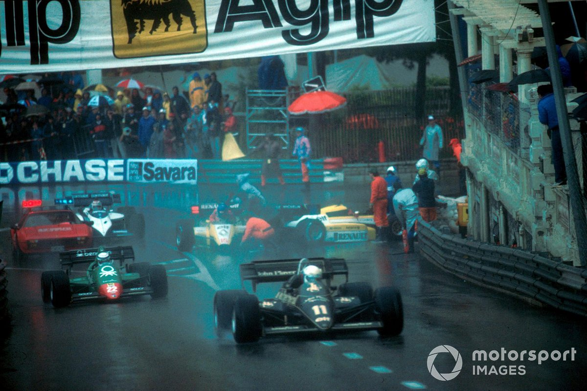 Elio de Angelis, Lotus 95T, passes Patrick Tambay, Renault RE50 and Derek Warwick, Renault RE50