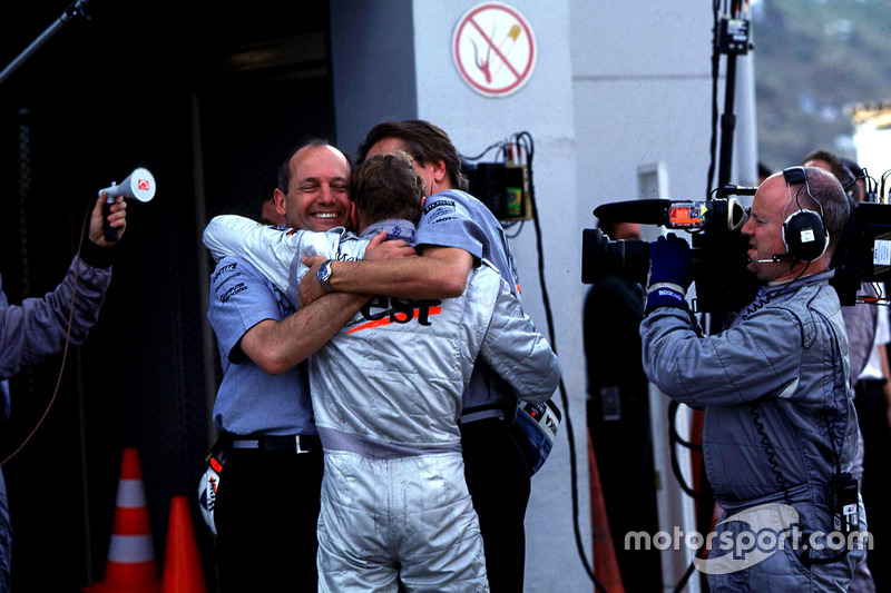 Ron Dennis and Mika Hakkinen, McLaren celebrate his Team Championship