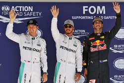 Qualifying top three in parc ferme (L to R): Nico Rosberg, Mercedes AMG F1, second; Lewis Hamilton,