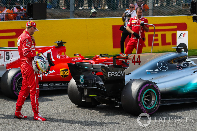 Sebastian Vettel, Ferrari looks at the Mercedes-Benz F1 W08  in parc ferme