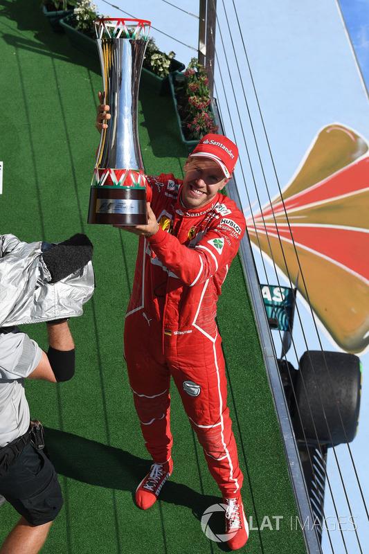 Подіум: переможець гонки Себастьян Феттель, Ferrari