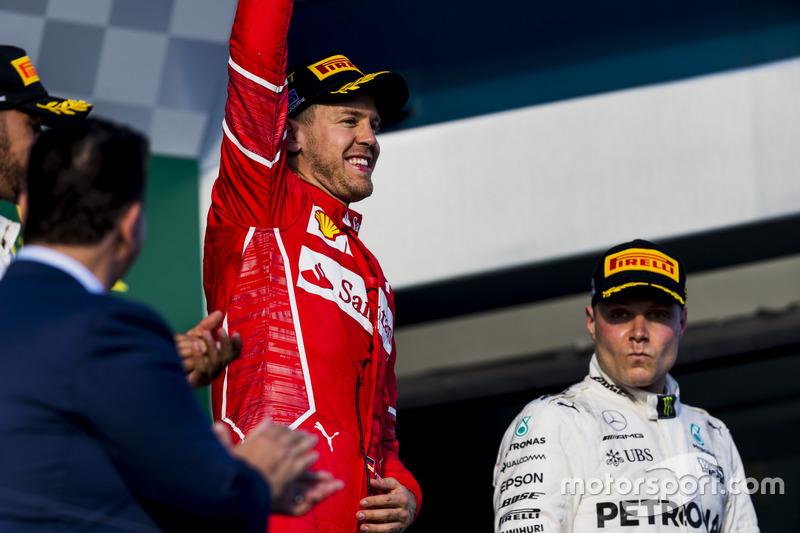Sebastian Vettel, Ferrari, 1st Position, celebrates on the podium