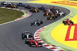 Sebastian Vettel, Ferrari SF70H, Lewis Hamilton, Mercedes AMG F1 W08, Valtteri Bottas, Mercedes AMG F1 W08, Max Verstappen, Red Bull Racing RB13, the rest of the field at the start, as Kimi Raikkonen, Ferrari SF70H, Max Verstappen, Red Bull Racing RB13, ge