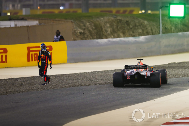 Daniel Ricciardo, Red Bull Racing RB14 Tag Heuer, walks away from his car after retiring early in the race with technical issues