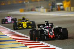 Romain Grosjean, Haas F1 Team VF-18 Ferrari, leads Carlos Sainz Jr., Renault Sport F1 Team R.S. 18